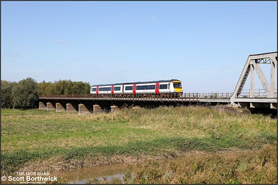 170271 crosses the Welney washes at Pymore whilst forming 2E76 1201 Ipswich-Peterborough on 18/09/2019.