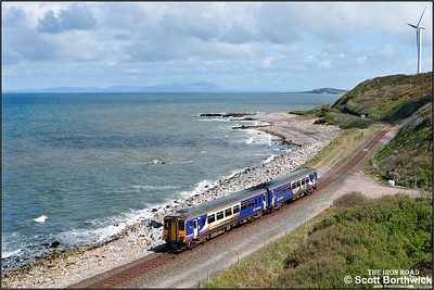 With the Scottish coastline of Dumfries & Galloway clearly visible across the Solway Firth, 156484 forms 2C42 0938 SO Carlisle-Lancaster passing Lowca on 30/05/2015.