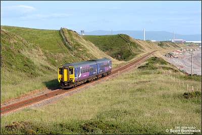 156443 approaches Nethertown whilst forming 2C47 1728 Barrow in Furness-Carlisle on 26/06/2013.