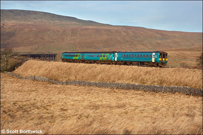 With 153317 on the rear, 156471 leads 2H10 0849 Leeds-Carlisle service away from Ribblehead on 21/01/2006.