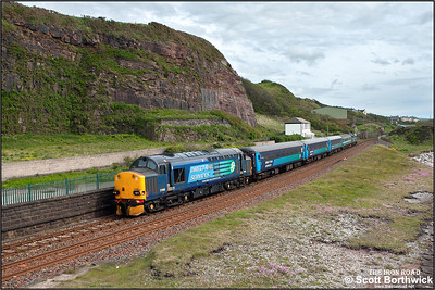 37606 brings up the rear of 2C34 1433 SO Carlisle-Barrow in Furness headed by 37423 'Spirit of the Lakes' passing Redness Point, Whitehaven on 30/05/2015.