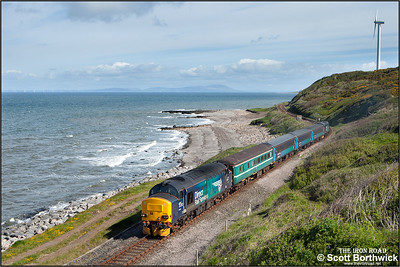 With the Scottish coastline of Dumfries & Galloway clearly visible across the Solway Firth, 37423 'Spirit of the Lakes' top & tails 37606 whilst forming 2C40 0842 SO Carlisle-Barrow in Furness passing Lowca on 30/05/2015.
