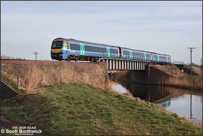 170202 is pictured crossing Twenty Foot River at Turves on 22/01/2005 with 1E74 0838 London Liverpool Street-Peterborough.