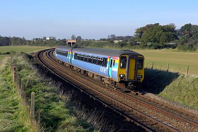 156407 passes Seven Mile Bridge, Higham whilst forming 2W15 1143 Cambridge-Ipswich on 04/11/2006.