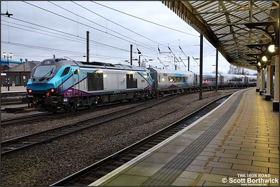 Website Caption 68019 propels 1E37 1256 Liverpool Lime Street-Scarborough away from its station stop at York on 05/12/2019.