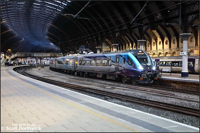 Website Caption Mk5 Driving Trailer 12808 leads 1E37 1256 Liverpool Lime Street-Scarborough away from its station stop at York on 05/12/2019.