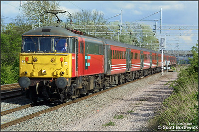 86424 on hire to Virgin West Coast works a northbound service from London Euston at Cathiron on 01/05/2002.