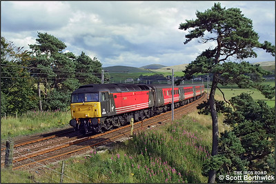 47854 'Womens Royal Voluntary Service' powers past Castle Hill, Crawford as it passes through the Scottish Borders whilst working 1S49 1031 Birmingham International-Edinburgh Waverley vice an AC electric locomotive on 16/08/2001.