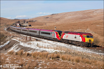 57314 'Firefly' drags 390038 across Blea Moor whilst working 1M16 1140 Glasgow Central-London Euston on 04/03/2006.