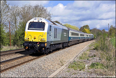 67013 and 67015 pass Claydon Crossing whilst top & tailing 1P03 0725 Wrexham General-London Marylebone on 28/04/2008.