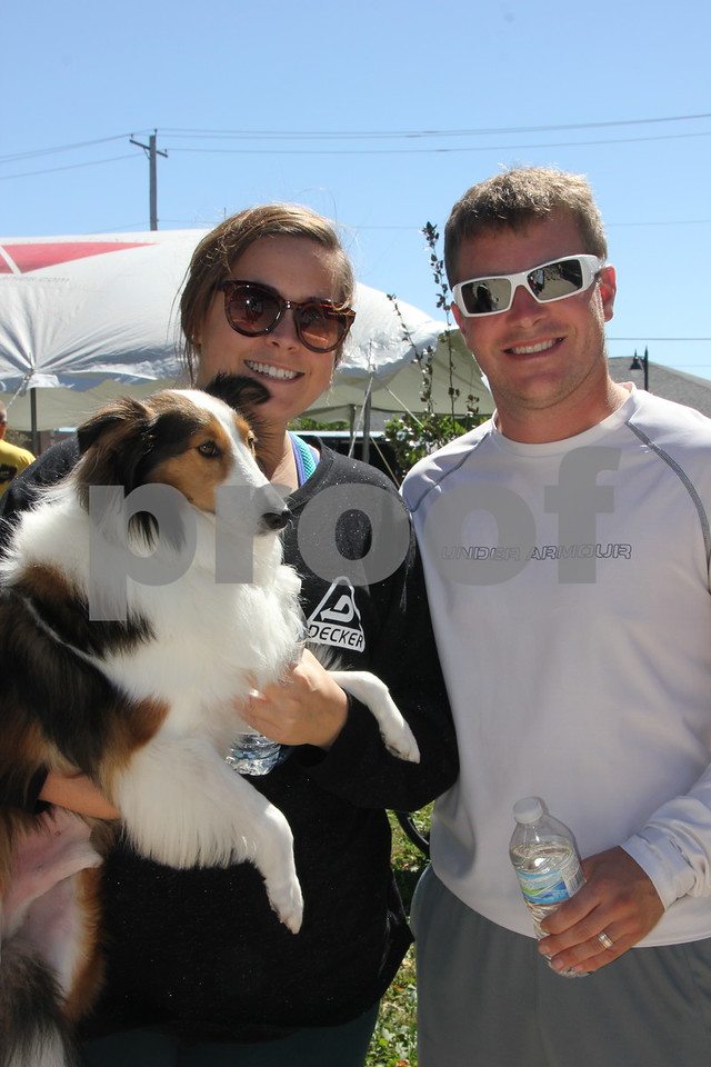 Opportunity Village Walk and Appreciation Lunch took place at the square by the library in Fort Dodge. The event was held on Sunday, September 11, 2016. Pictured is (left to right): Lui (the dog), and Jennifer and Shawn Lawler.