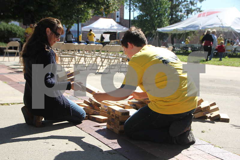 Opportunity Village Walk and Appreciation Lunch took place at the square by the library in Fort Dodge. The event was held on Sunday, September 11, 2016. Here (from left to right )is Cindy Ferguson and Jack Summers setting up the Jenga game together.