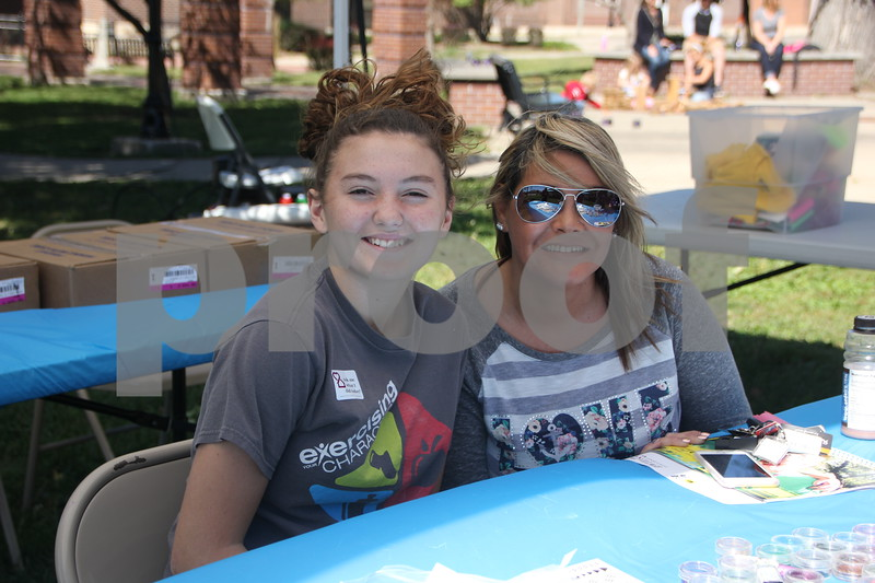 Opportunity Village Walk and Appreciation Lunch took place at the square by the library in Fort Dodge. The event was held on Sunday, September 11, 2016. Pictured (left to right) is: Jadin Roest and Candice Silano.