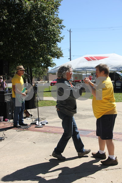 Opportunity Village Walk and Appreciation Lunch took place at the square by the library in Fort Dodge. The event was held on Sunday, September 11, 2016. (Left to right) Sally Craig and Josh Keeling dance to the music of the band Road Toast ( seen playing in the background on the left).
