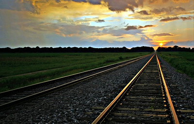 sunset3 A beautiful delta sunrise or sunset! Southern transportation comes in all forms. From tractors to mules, from trains to boats!