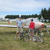 Group photo with our folding bikes and airplane all covered up for our big adventure on the island
