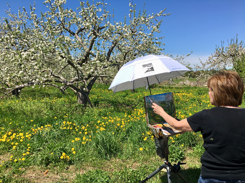 . Billerica resident Mary Rose O\'Connell adjusted the umbrella that shaded her masterpiece. Photo by Mary Leach