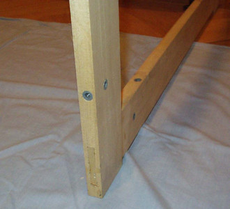 Each frame is made of poplar with through mortise and tenon construction.  The base of the case is assembled using bolts and threaded inserts (a LOT of bolts and threaded inserts).
