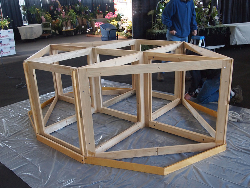 These units are bolted into a large hexagon.  Four of the skirting pieces are hinged in the middle and bolt through the ends.  Note how the hexagon will become a decagon.