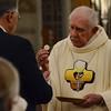 Bishop Joe shares the Eucharist