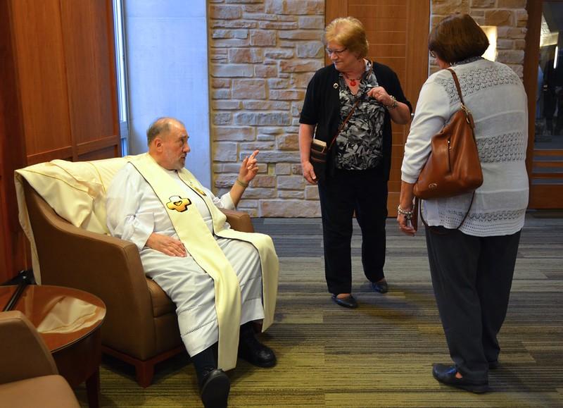 Fr. Tony looks like he is giving a little advice before Mass