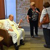 Fr. Tony looks like he is giving a little advice before Mass