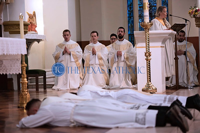 The three candidates for priesthood prostrate on the altar before their brother priests during the Mass of Ordination to the Priesthood June 1 at the Cathedral Shrine of the Virgin of Guadalupe.