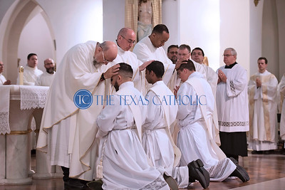 The newly ordained priests receive blessings from theirbrother priests during the Mass of Ordination June 1 at the Cathedral Shrine of the Virgin of Guadalupe.