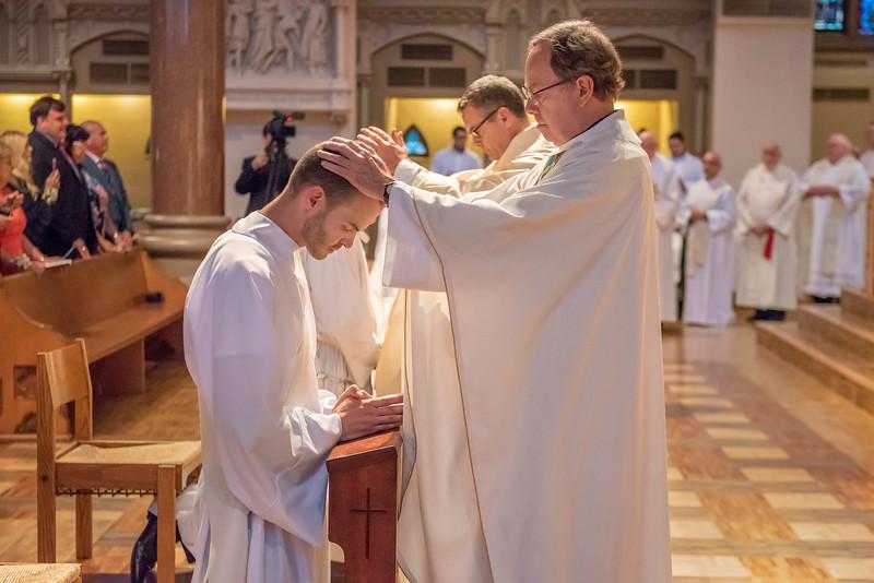Fr. Michael Harter, SJ, blesses Michael Wegenka, SJ.