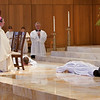 In an ancient act symbolizing humility, obedience, and willingness to live by Christ's example, Frs. Whitaker and Schreiber lie prostrate on the floor in response to the Bishop's invitation to prayer.