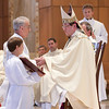 The Bishop anoints the hands of the newly ordained with chrism, the oil that is used in the sacraments of baptism and confirmation, as a sign that they now share in the mission of Christ.