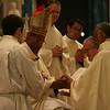 Fr. Joel Medina, SJ, kneels before The Most Rev. William D'Souza, archbishop of Patna, at the Ordination Mass at St. Xavier Church, Cincinnati, Ohio on Saturday, June 11, 2011.