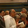 Fr. Joel Medina, SJ, of Jackson, Michigan (foreground) at his Ordination Mass at St. Xavier Church, Cincinnati, Ohio, on Saturday, June 11, 2011.