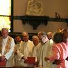 After receiving his vestments, Fr. Joel Medina, SJ, embraces his mother, Maria Amada Gomez, at his Ordination Mass at St. Xavier Church, Cincinnati, Ohio, on Saturday, June 11, 2011.