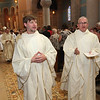 Fr. Bill Blazek, SJ, and Fr. Paul Lickteig, SJ, lead the processional out of St. Thomas More Church in St. Paul, Minnesota, on June 9, 2012.