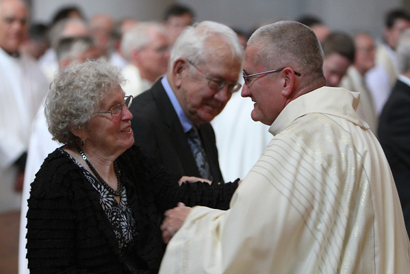 Fr. Bill Blazek, SJ, greets and celebrates his ordination with his parents.