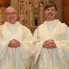 Newly ordained Frs. Bill Blazek and Paul Lickteig are photographed immediately following their Ordination Mass at St. Thomas More Church in St. Paul, Minnesota, on June 9, 2012.