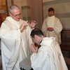 Fr. Bill Blazek, SJ, confers a blessing on Archbishop Neinstedt at the Ordination Mass at at St. Thomas More Church<br /> in St. Paul, Minnesota, on June 9, 2012