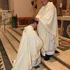 Fr. Bill Blazek, SJ, confers a blessing on fellow ordinand, Fr. Paul Lickteig, SJ, at the Ordination Mass at St. Thomas More Church in St. Paul, Minnesota, on June 9, 2012.