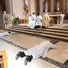 In an ancient act symbolizing humility, obedience, and willingness to live by Christ's example, Frs. Bill Blazek and Paul Lickteig lay prostrate on the floor in response to the Bishop's invitation to prayer. As the man prays, the People of God sing the Litany of the Saints asking holy women and men throughout history to guide them in their ministries.