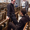Eric M. Sundrup, SJ (left), shares a quiet moment before his ordination on June 7, 2014, at Church of the Gesu in Milwaukee.