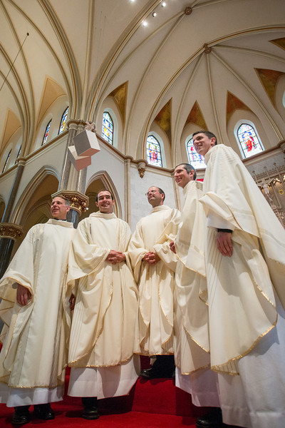 Five Jesuits were ordained on June 7, 2014, at Church of the Gesu in Milwaukee by the Most Reverend Richard Sklba, DD, Auxiliary Bishop Emeritus of Milwaukee. Pictured here, left to right, are Fr. Christopher P. Johnson, Fr. Eric M. Sundrup, Fr. John F. Shea, Fr. Nathan C. Wendt, and Fr. Paul J. Shelton.