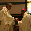 Fr. Joel Medina, SJ, confers a blessing on the Most Rev. William D'Souza, archbishiop of Patna at the Ordination Mass at St. Xavier Church, Cincinnati, Ohio on Saturday, June 11, 2011.