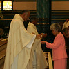 Fr. Joel Medina, SJ, presents the Blessed Sacrament to his mother, Maria Amada Gomez, at his Ordination Mass at St. Xavier Church, Cincinnati, Ohio, on Saturday, June 11, 2011.