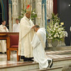 n the tradition of the apostles, the ordaining bishop and fellow priests lay hands on the head of the candidate and pray silently as a sign of the conferral of the Holy Spirit, who ordains one to serve in Holy Orders. Here The Most Rev. William D'Souza, archbishop of Patna, confers a blessing on Fr. Joel Medina, SJ, of Jackson, Michigan, at the Ordination Mass at St. Xavier Church, Cincinnati, Ohio, on Saturday, June 11, 2011.