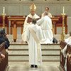Fr. Joel G. Medina, SJ, of Jackson, Michigan, stands reverently before The Most Rev. William D'Souza, archbishop of Patna and the congregation of family and friends during his Ordination Mass at St. Xavier Church, Cincinnati, Ohio, on Saturday, June 11, 2011.