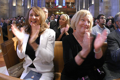 Deborah Briese, Llane Briese's mother, and Ozella Martinez, his grandmother from San Antonio, Texas, applaud during the presentation of the six ordination candidates.