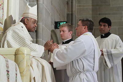 Ordination candidate Mark Starr pledges his obedience and respect to Archbishop Gregory and his successors.