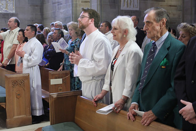 (L-r, front row) Immaculate Heart of Mary Church parishioners Fernando and Yolanda Munoz stand with ordination candidate Feiser Munoz Polanco, as Dennis Dorner Jr. stands with his mother Susan and his grandfather Donald Dorner just following the opening procession.