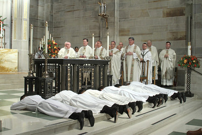 All six ordination candidates prostrate themselves before the altar during the Litany of Saints at the Cathedral of Christ the King, Atlanta.